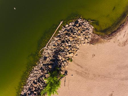 Aerial view of ocean beach. Sand beach and sea view from above. Beach aerial view of ocean water and sand shore.