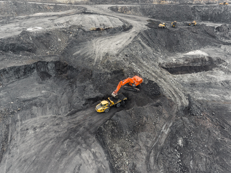 Aerial view open pit mine, loading of rock, mining coal, extractive industry