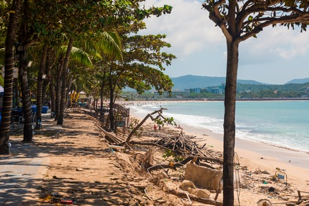 SANYA, CHINA - SEPTEMBER 28, 2017: Consequences after typhoon, on the island of Hainan. Destructions after night hurricane on the coast of the South China Sea. Sanya Редакционное