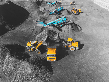 View from above, on the process of sorting coal mined. Open pit mine, Mining coal extractive industry anthracite.