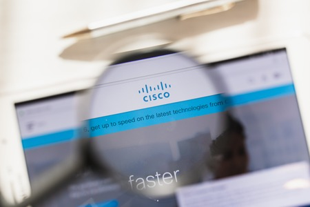 Los Angeles, California, USA - 27 February 2019: Cisco Systems, Inc. official website homepage under magnifying glass. Concept Cisco Systems, Inc. logo visible on smartphone, tablet screen,
