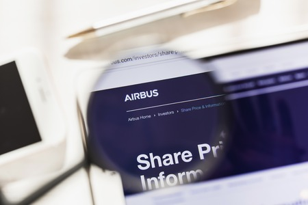 Toulouse, France - 27 February 2019: Airbus SE official website homepage under magnifying glass. Concept Airbus SE logo visible on smartphone, tablet screen, Editorial
