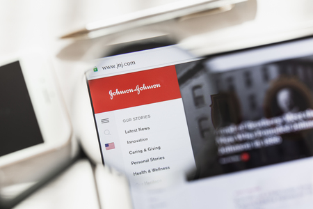 New York, USA - 4 March 2019: Johnson, JNJ, official website homepage under magnifying glass. Concept Johnson, JNJ logo visible on smartphone, tablet screen, Editorial