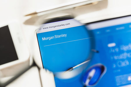New York, USA - 4 March 2019: Morgan Stanley official website homepage under magnifying glass. Morgan Stanley logo visible on smartphone, tablet screen