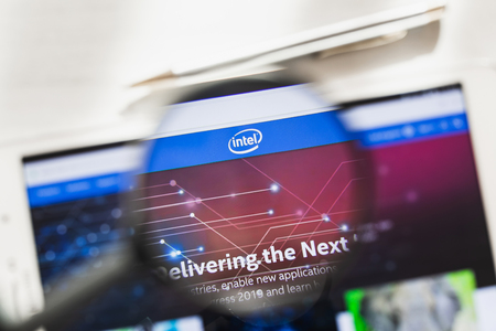 California, USA - 7 March 2019: Intel Corporation official website homepage under magnifying glass. Concept Intel Corporation, CPU logo visible on smartphone, tablet screen,