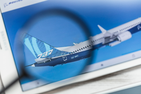 Bishoftu, Ethiopia - March 15, 2019: Boeing Company, 737 max, official website homepage under magnifying glass. Concept Boeing Company, 737 max, Aircraft logo visible on smartphone, tablet screen Editorial