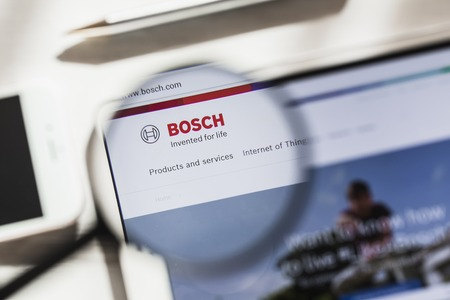 Gerlingen, Germany - March 16, 2019: Robert Bosch GmbH, official website homepage under magnifying glass. Concept Bosch logo visible on smartphone, tablet screen Editorial