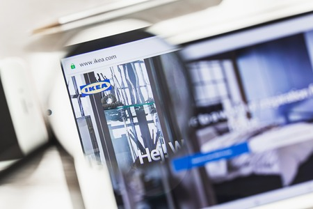 Leiden, Netherlands - March 16, 2019: IKEA Group, Sweden, Retail, official website homepage under magnifying glass. Concept IKEA, Sweden, Retail, logo visible on smartphone, tablet screen