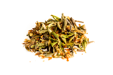 Aromatic crumbly Handful of Dry tea leaves isolated on white background. Green and black dry tea, isolated on white Stock Photo