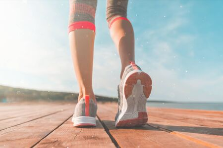 Legs in sneakers close-up. Health and Yoga Concept.
