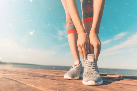 Legs in sneakers close-up. Health and Yoga Concept