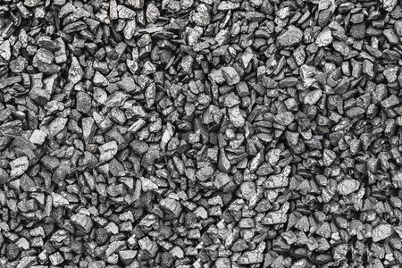 Texture coal. Natural black coals for background. Industrial coal. Coal mining. Shot CloseUp of black anthracite for background