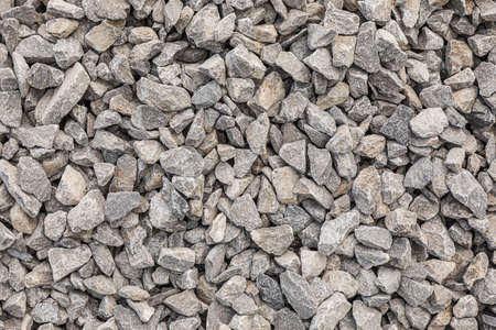 Grey crushed pebbles, background image. Crushed stone texture.