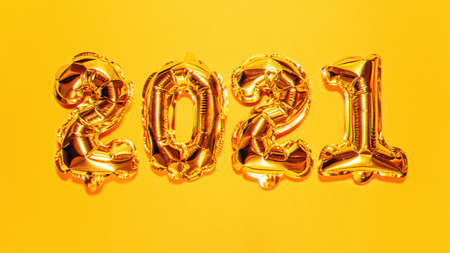 Happy New year 2021 celebration. Bright gold balloons figures, New Year Balloons on bright yellow background. Christmas celebration. Gold foil balloons numeral 2021 with 3d effect, VR concept