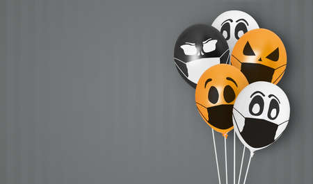 Colored balloons with faces in medical mask for Halloween party on dark background. Space for text. Happy holiday October 31. Halloween celebration concept in the midst of covid-19 and coronavirus