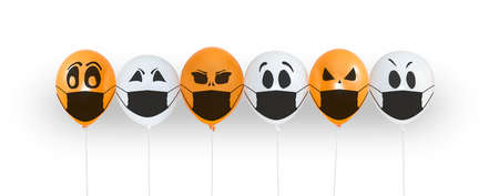 Colored balloons with faces in medical mask for Halloween party on white background. Space for text. Happy holiday October 31. Halloween celebration concept in the midst of covid-19 and coronavirus Foto de archivo