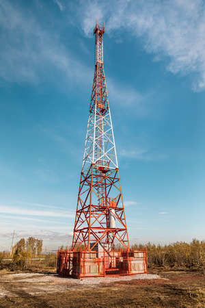 New telecommunication antenna on background of blue sky in the forest. Satellite dish telecom network at communication technology network. Telecom broadcasting tower. Cell tower Foto de archivo