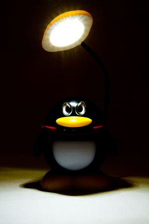 Desk lamp the Penguin. Stock Photo