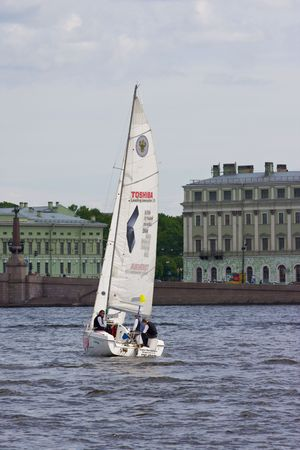 Sailing Regatta in St. Petersburg, Russia. Yachts sailing on the river under the blue sky