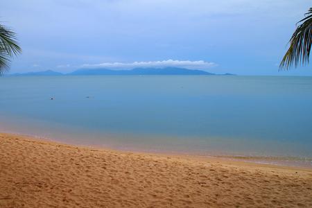 Tropical beach with island palm trees blue cloud Stock Photo