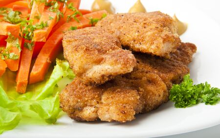 breadcrumbs: chicken fried in breadcrumbs with vegetables Stock Photo