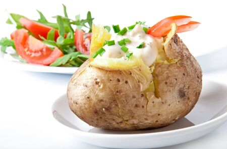 jacket potato: Baked potato filled with sour cream and arugula