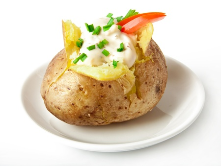Baked potato filled with sour cream  Stock Photo