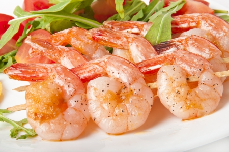 Fresh grilled shrimps with lemon on white plate Stock Photo - 14186670