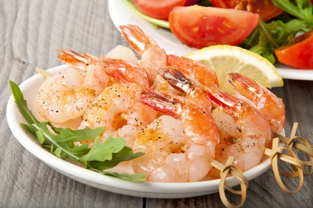 Fresh grilled shrimps with lemon on white plate Stock Photo