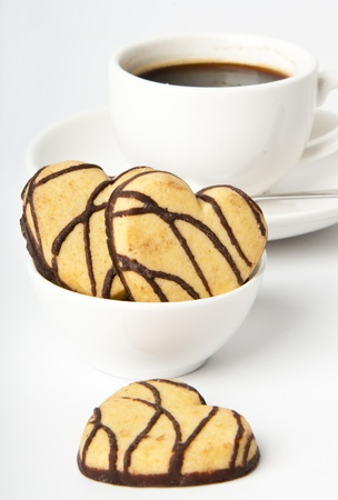 cup of coffee and cookies in a heart-shaped chocolate photo