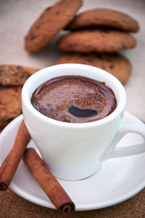 cup of coffee and cookies with chocolate photo