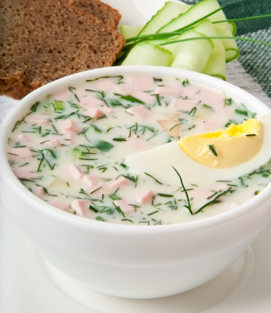 Cold vegetable kefir soup with eggs and greens Stock Photo