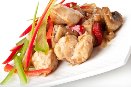 Stir fry chicken with sweet peppers and mushrooms photo