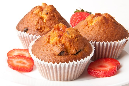 strawberry cake: Strawberry muffin on a white plate with a fresh strawberry