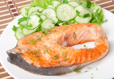 Fish dish - grilled salmon with vegetables photo