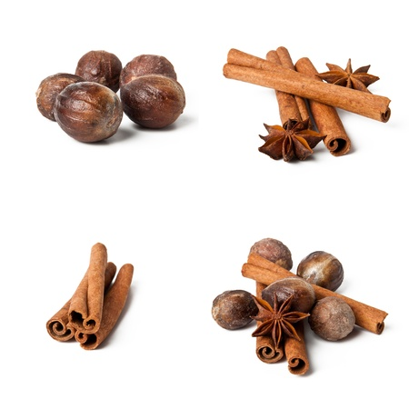 Cinnamon, anise, nutmeg, and cloves isolated on white background Stock Photo