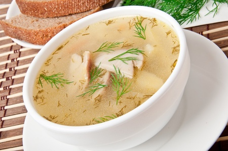 Mushroom soup garnished with fresh dill photo