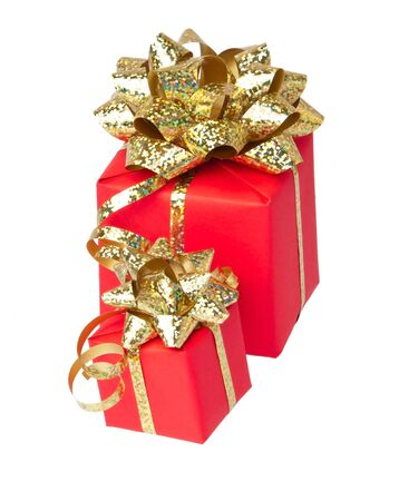 Two gifts wrapped with golden bow, white background photo