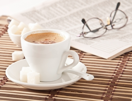 cup of coffee, sugar and newspaper closeup photo