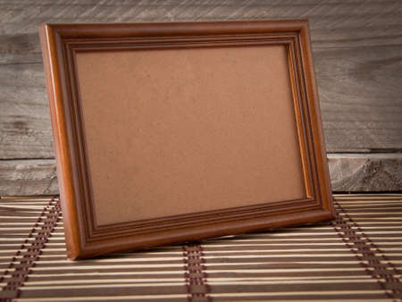 time frame: old photo frame on the village background Stock Photo