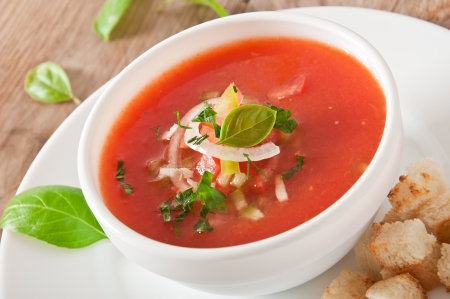 delicious cold Gazpacho soup in white bowl Stock Photo