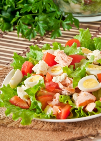 fresh salmon salad, lettuce and quail eggs Stock Photo