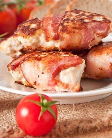 grilled chicken patties wrapped strips of bacon photo