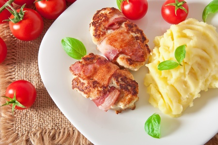 grilled chicken patties wrapped strips of bacon and mashed potatoes Stock Photo - 17044669