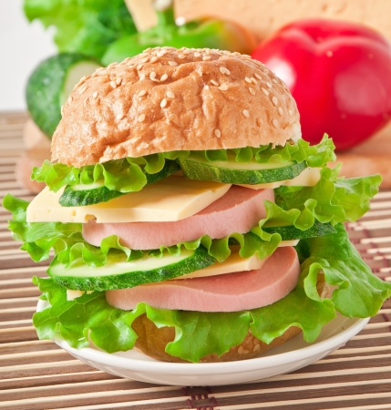 Sandwich with sausage cheese and greens photo