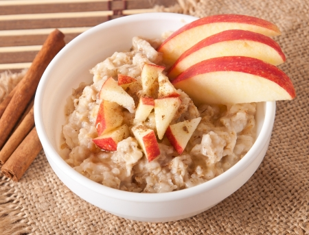 Oatmeal with apples and cinnamon in a white bowl Stock Photo