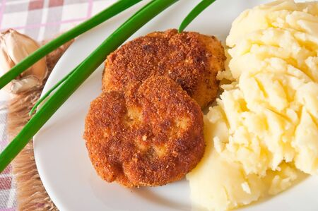 Fried cutlets in breadcrumbs and mashed potatoes photo