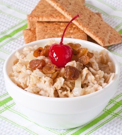 Oatmeal with raisins and cherries in a white bowl Stock Photo - 18067578