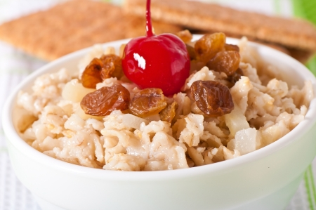 Oatmeal with raisins and cherries in a white bowl Stock Photo - 18067583