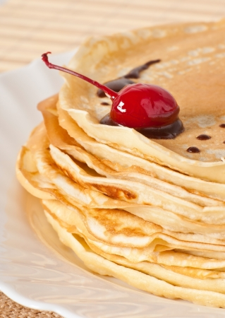 pancakes with chocolate and cherries Stock Photo